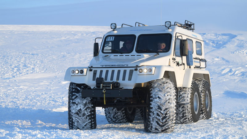 russias-president-vladimir-putin-seen-in-an-allterrain-vehicle-at-picture-id660231282