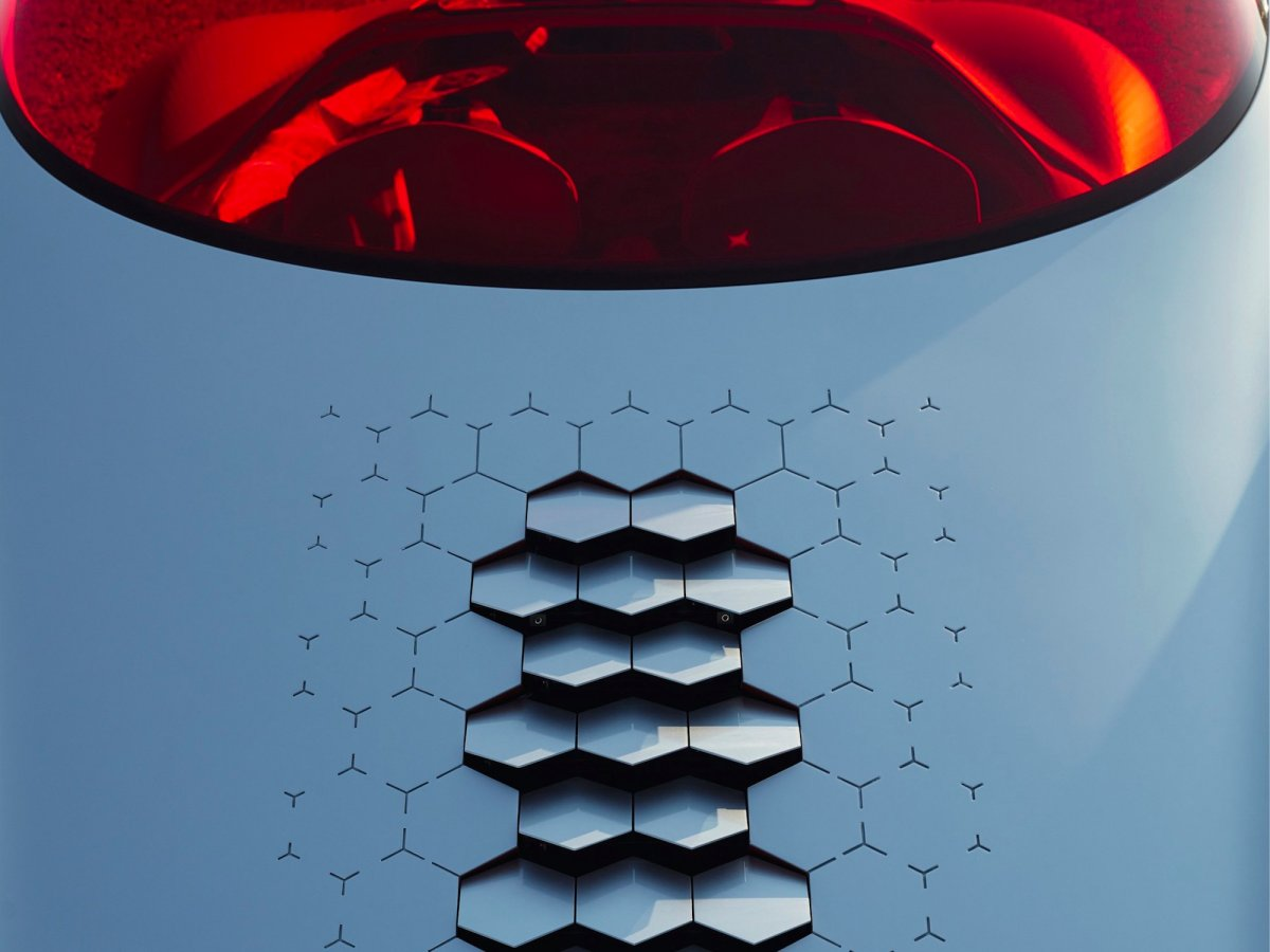 the-hexagonal-vents-on-the-hood-are-part-of-that-cooling-system-they-move-up-and-down-as-air-circulates-to-give-the-impression-that-the-car-is-breathing