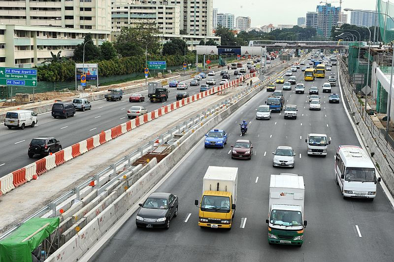 Photo taken on December 1, 2010 shows vehicles plying along central expressway in Singapore. Singapore prides itself on being a clean and green city but a high-consumption lifestyle resulting from a booming economy has made it one of the world's biggest carbon polluters per person.AFP PHOTO/ROSLAN RAHMAN (Photo credit should read ROSLAN RAHMAN/AFP/Getty Images)